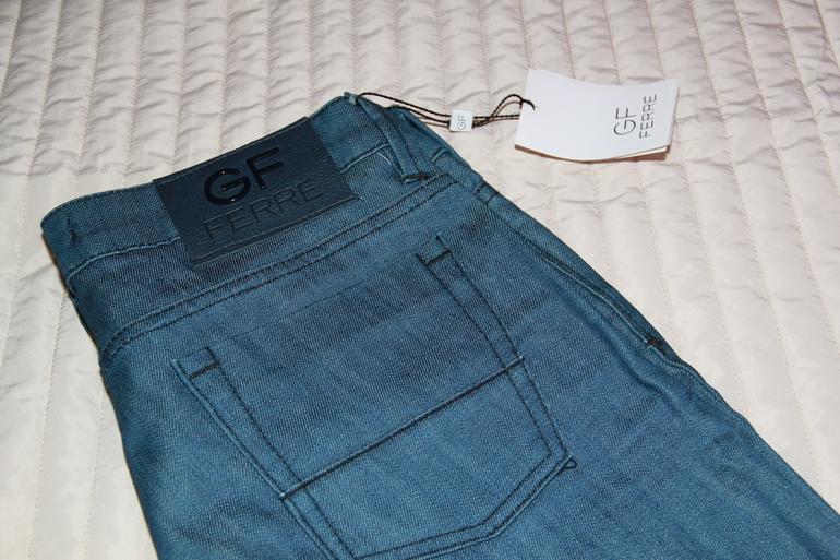 Новая  фирменная  одежда